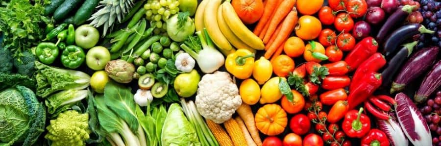 Fruits and vegetables in rainbow colors.