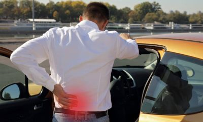 Back pain due to bad posture while driving.